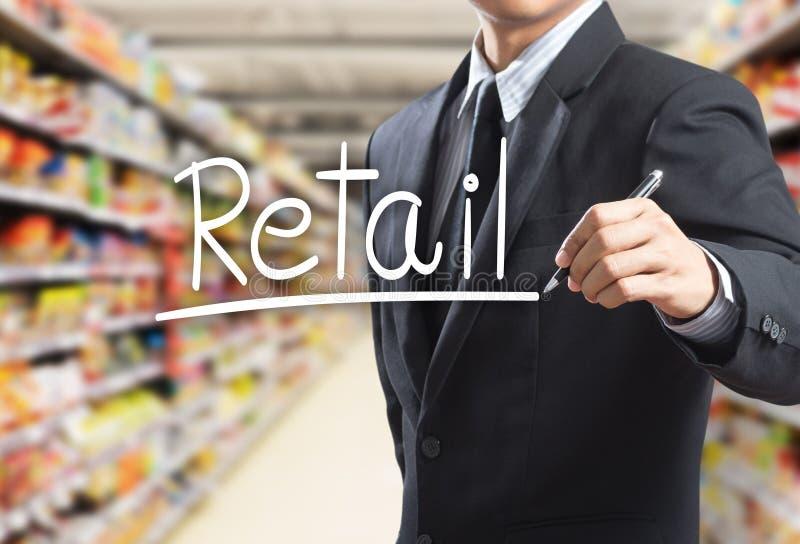 Розница слова сочинительства бизнесмена стоковые изображения