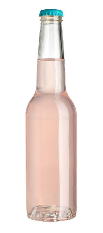 Розовая жидкость в стеклянной бутылке стоковая фотография