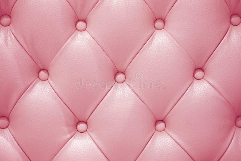 Розовая кожаная текстура софы стоковая фотография