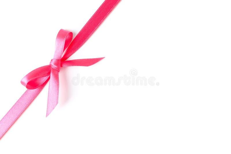 Розовая лента со смычком изолированным на белой предпосылке стоковое изображение