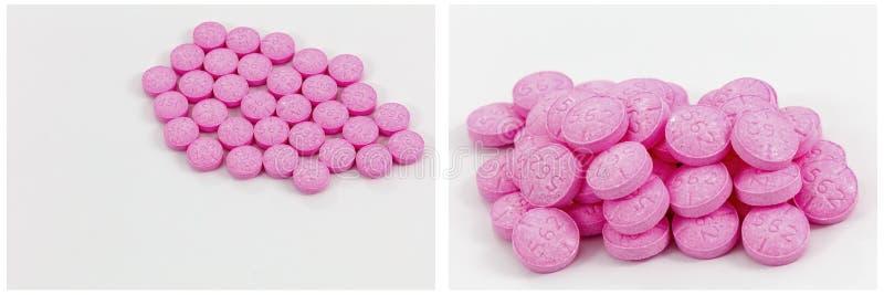 Розовая предпосылка белизны рецепта лекарства пилюлек стоковая фотография rf