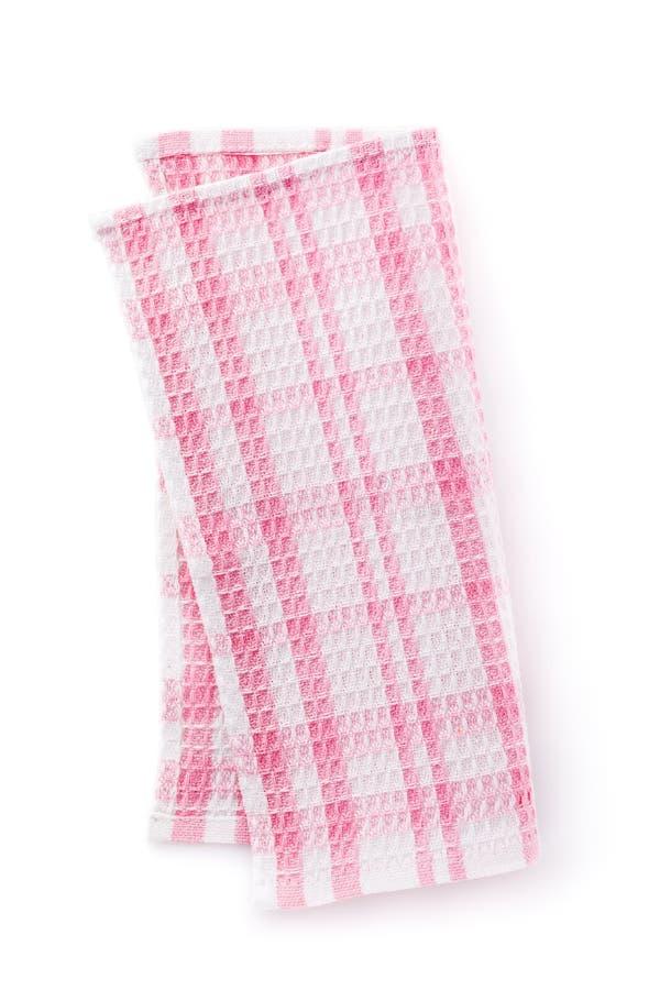 Розовая салфетка хлопка сложила в половине, изолированной на белой предпосылке стоковое изображение rf