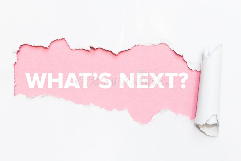 Розовое отверстие в белой бумаге Что следующее стоковые фотографии rf