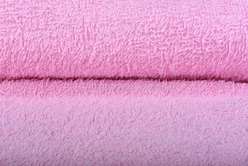 Розовое полотенце Terry Текстура полотенец ткани стоковые изображения rf