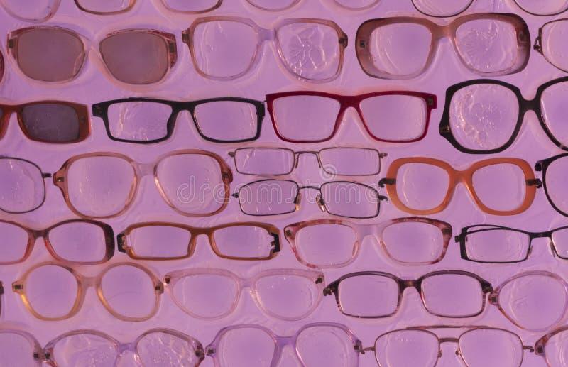 Розовое фото предпосылки солнечных очков стоковые изображения
