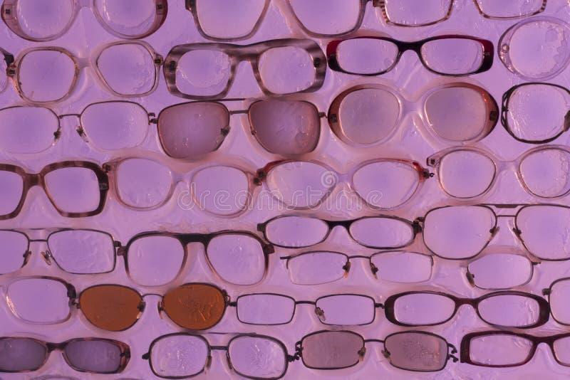 Розовое фото предпосылки солнечных очков стоковые фото