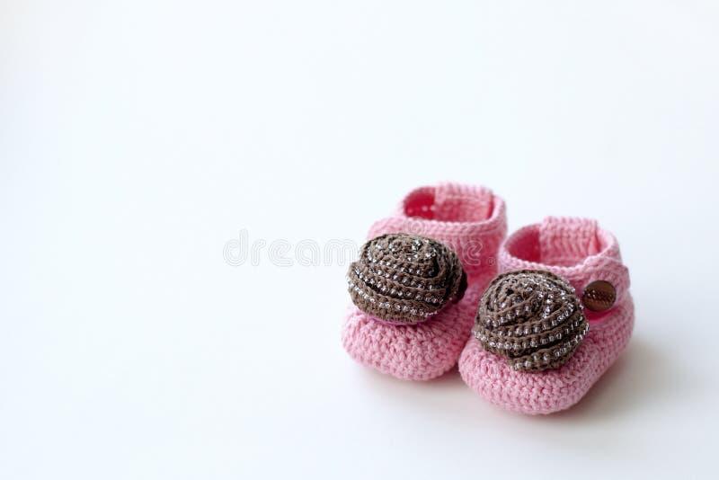 Розовое baby& x27; bootees s стоковые фотографии rf