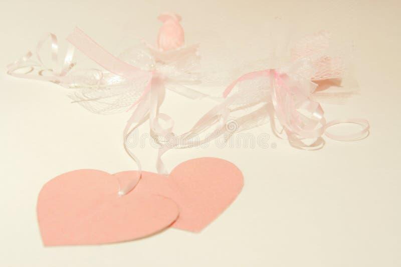 Розовые сердца и тесемки стоковое изображение