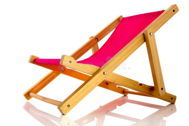 Розовый стул пляжа стоковое фото
