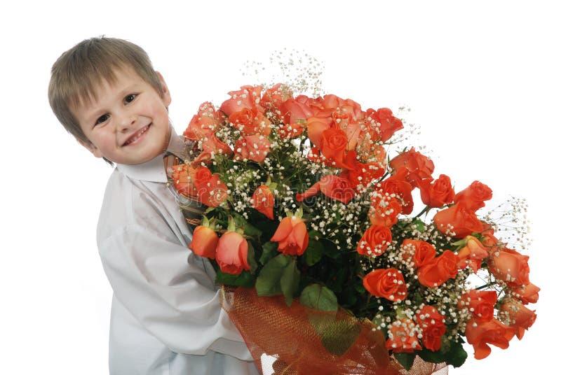 розы мальчика стоковое изображение rf