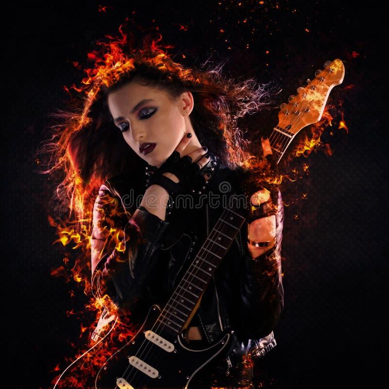 Рок-звезда на огне стоковое изображение