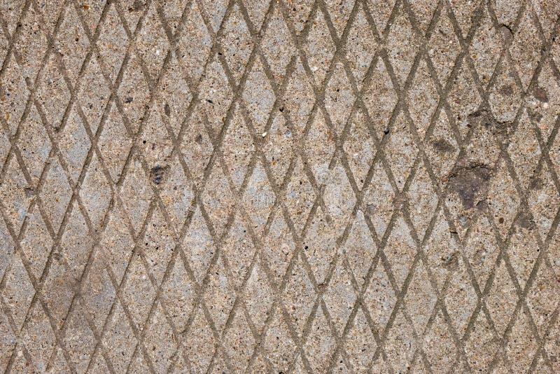 Ромбовидный узор конкретной мостовой Вертикальная форма диаманта стоковые фото