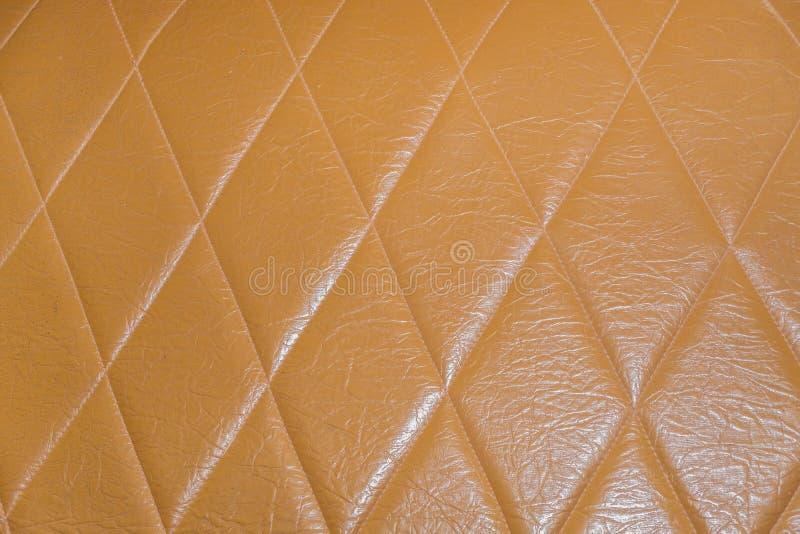 Роскошная русая кожаная предпосылка текстуры софы стоковые фотографии rf