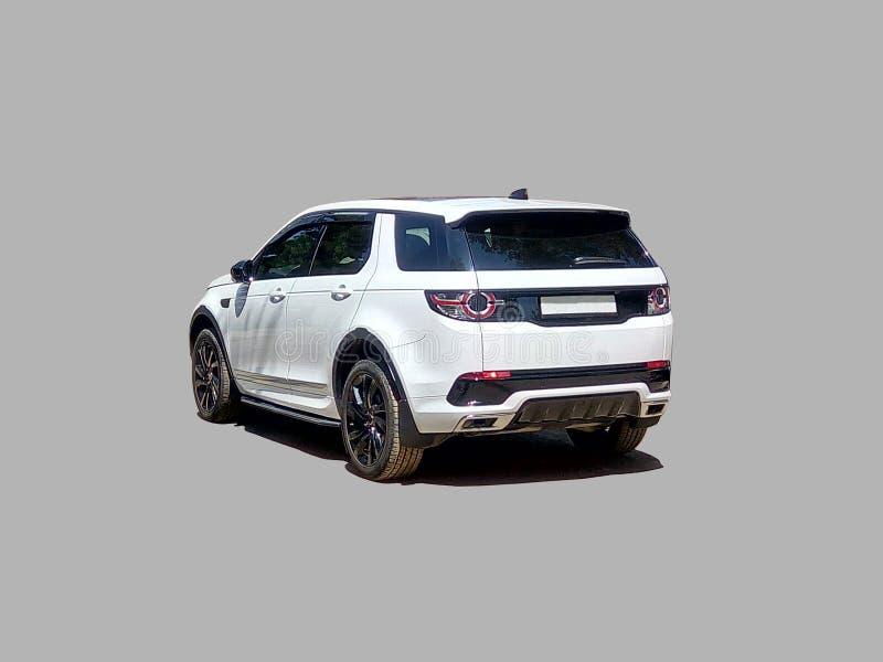 Роскошное белое suv автомобиля от позади стоковые фотографии rf