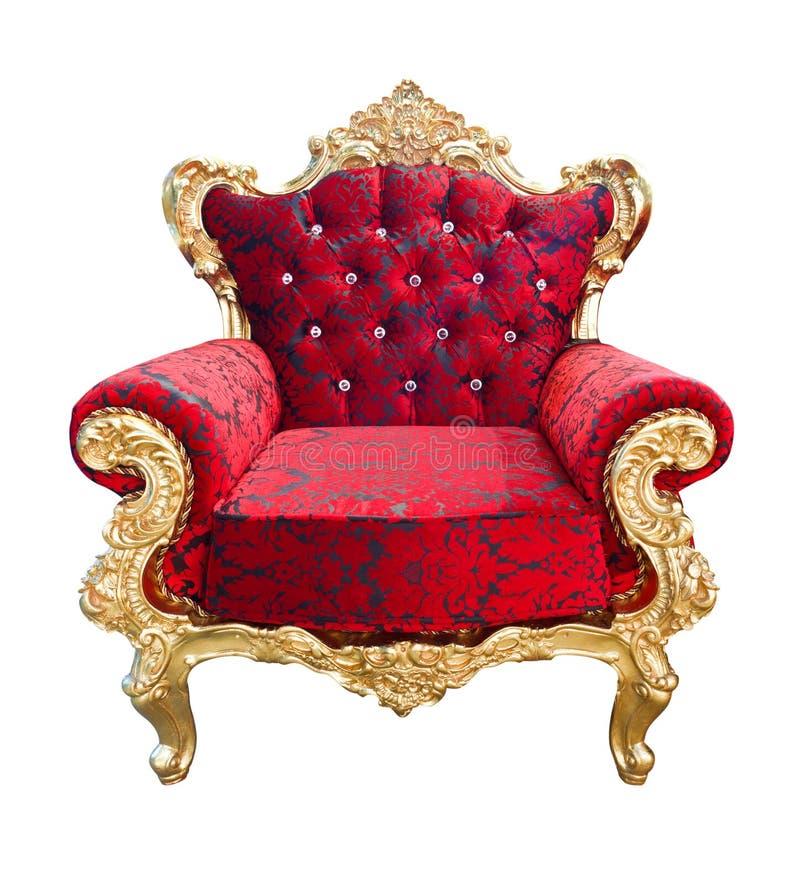 Роскошное красное и золотое изолированное кресло стоковое фото rf