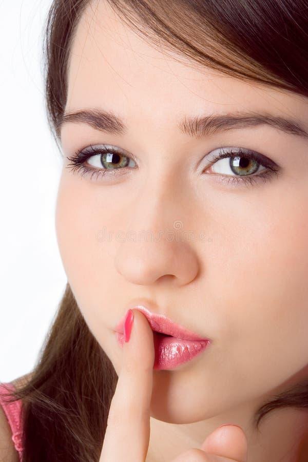 рот владением девушки fron перста красотки говорит sh стоковое изображение