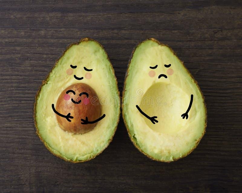 Родитель авокадоа с младенцем и одним снаружи стоковые изображения