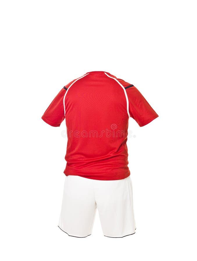 рубашка футбола красная замыкает накоротко белизну стоковая фотография
