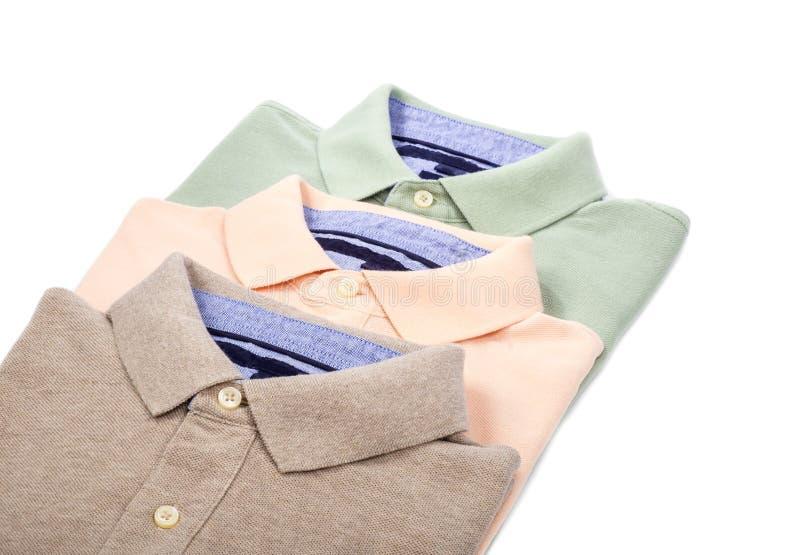 Рубашки поло людей изолированные на белизне стоковые изображения rf