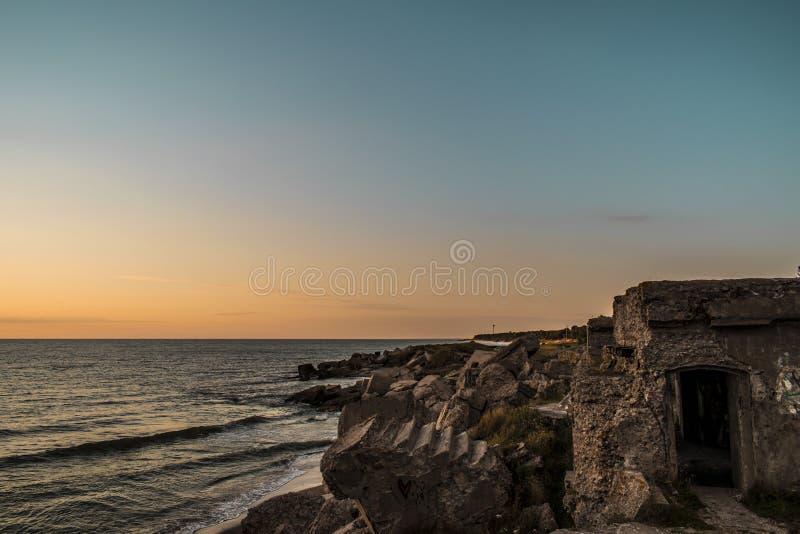 Руины северных фортов во время захода солнца в Liepaja, Латвии стоковое фото rf