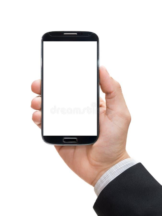 Рука бизнесмена держа умный телефон (мобильный телефон) стоковая фотография rf