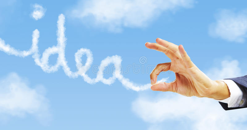 Рука бизнесмена сжимая слово идеи. стоковые изображения rf