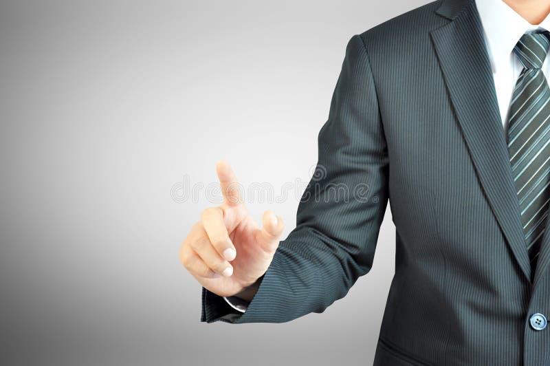 Рука бизнесмена указывая на пустой космос стоковое фото