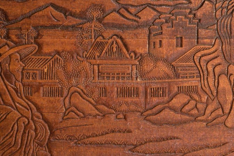 Рука высекла в древесине стоковое фото