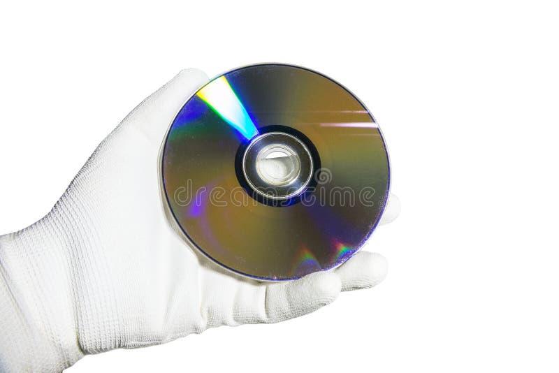 Рука в белой перчатке держа КОМПАКТНЫЙ ДИСК компакт-диска стоковые изображения rf