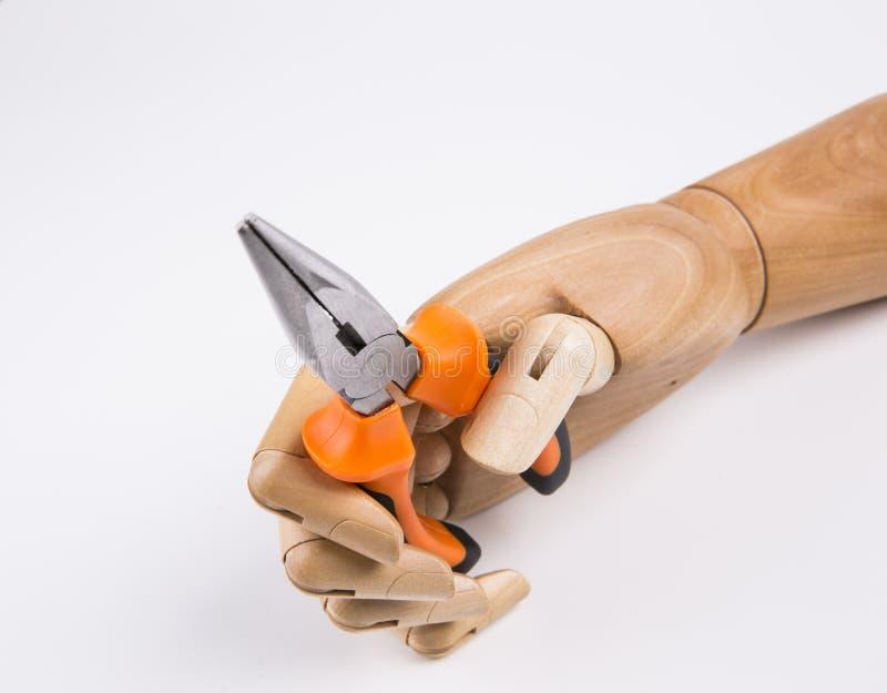 Рука держащ плоскогубцы стоковое фото rf
