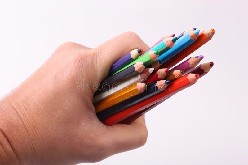 Рука держа деревянный цвет стоковые изображения