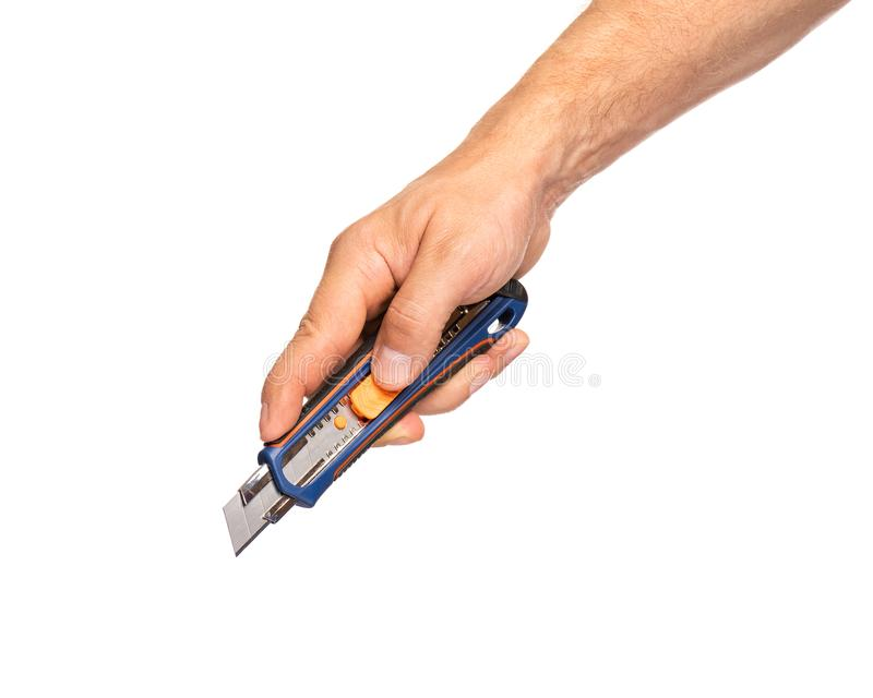 Рука держа нож канцелярских принадлежностей стоковое фото rf