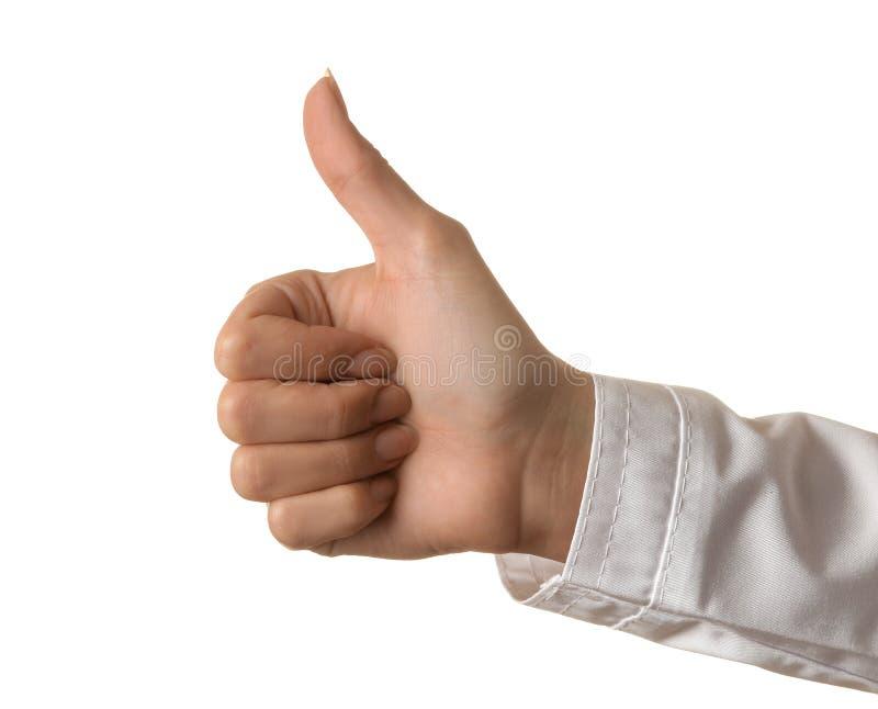 Рука доктора женщины показывает большой палец руки вверх на белой изолированной предпосылке рука жестов стоковые фото