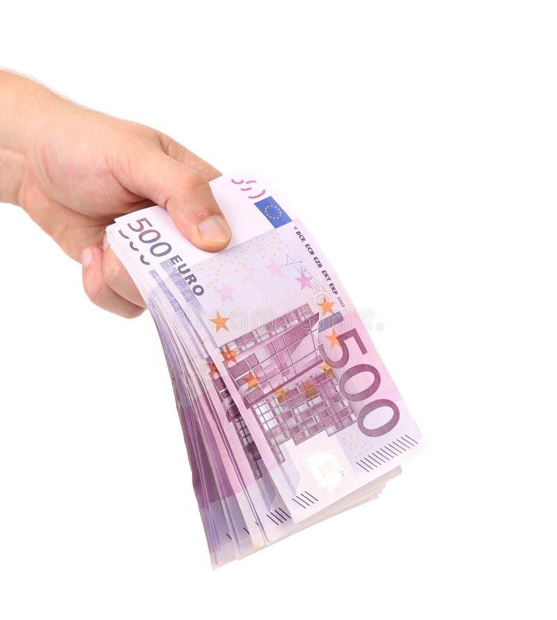 Рука держа 5 банкнот евро сотен стоковые изображения