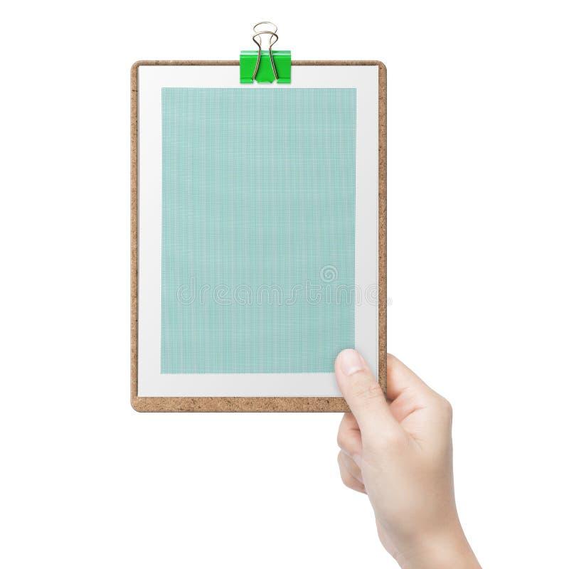 Рука держа зеленую доску сзажимом для бумаги стоковые изображения