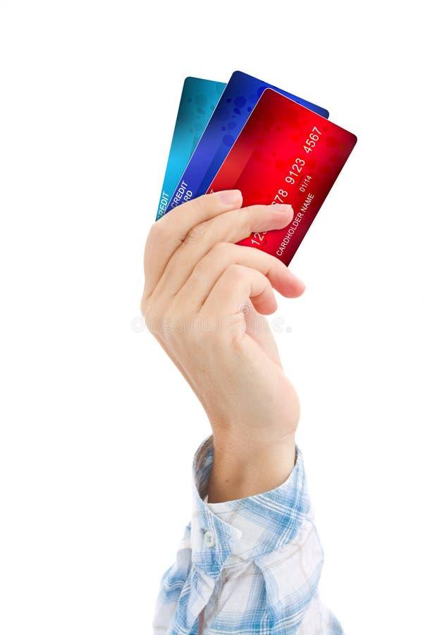 Рука держа кредитные карточки стоковые изображения