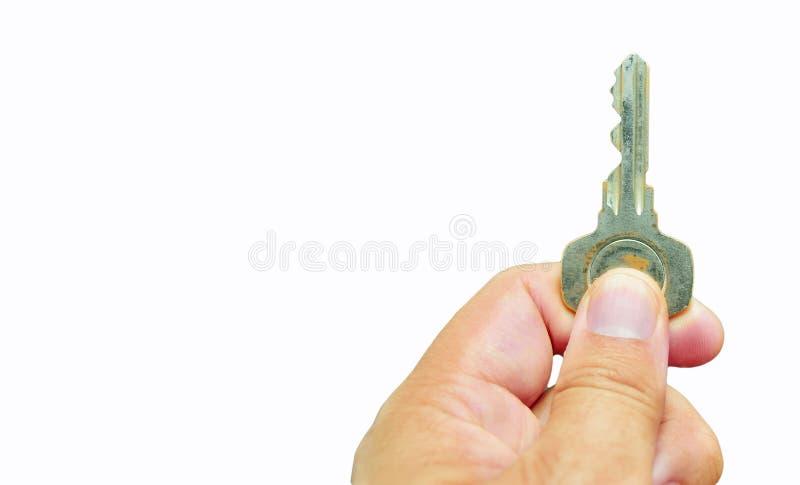 Рука держа ключ стоковые изображения rf