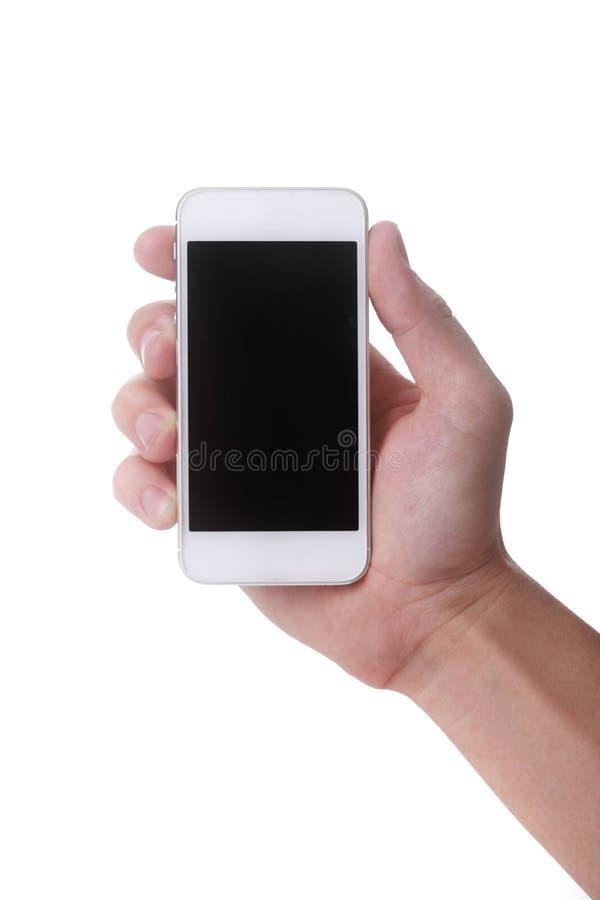 Рука держа мобильный телефон касания умный стоковая фотография