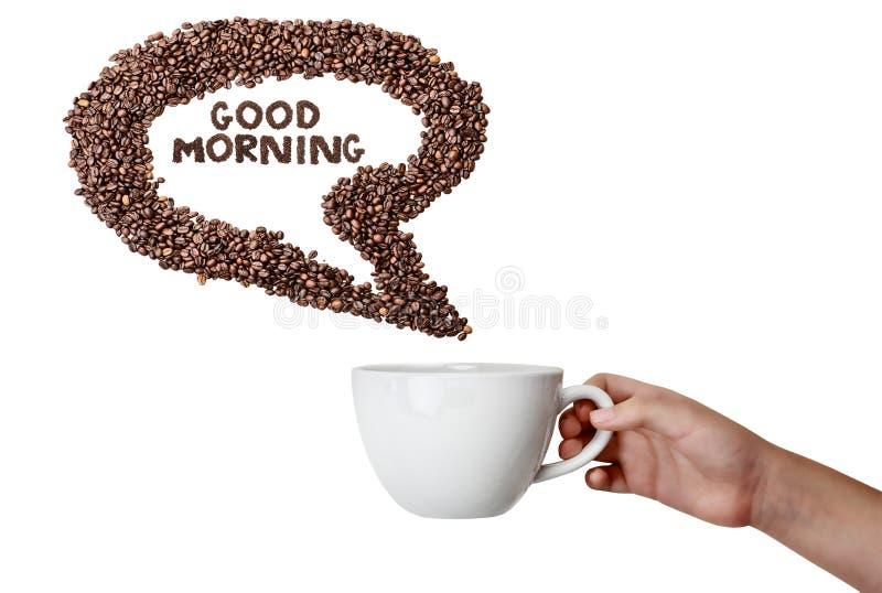 Рука держа пузырь речи кофейного зерна чашки и стоковые изображения