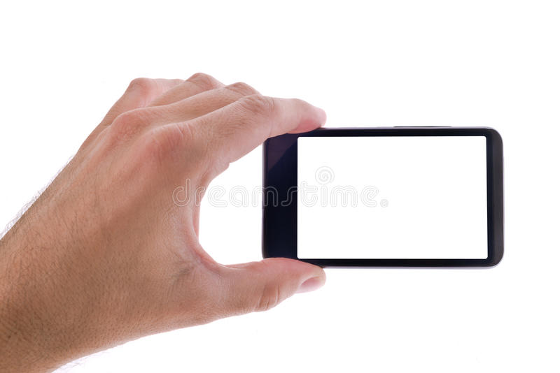 Рука держа родовой мобильный телефон с пустым экраном стоковое изображение rf