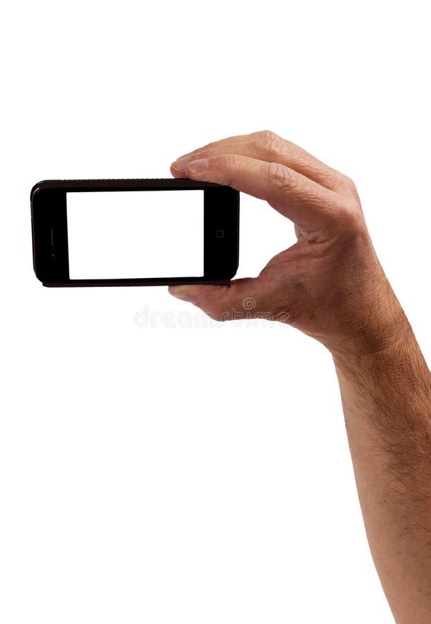 Рука держа умный телефон изолированный на белизне стоковые фото