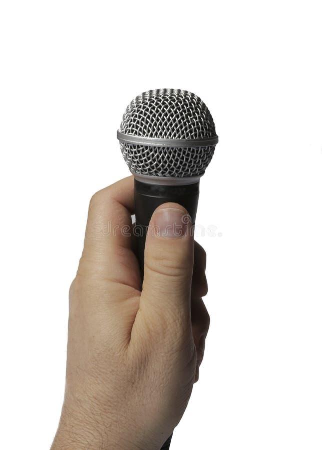 Рука держа mic стоковая фотография rf