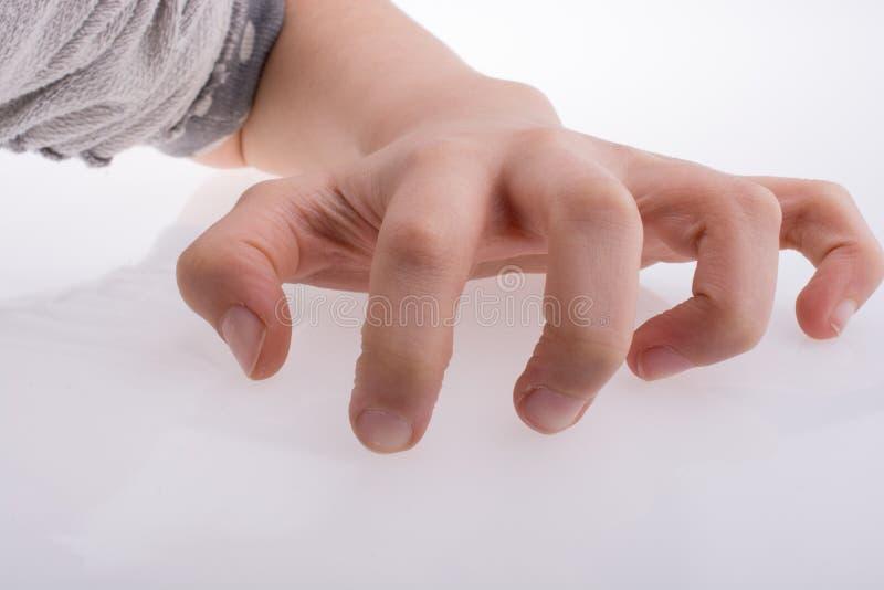 Рука делая жест хватать стоковая фотография
