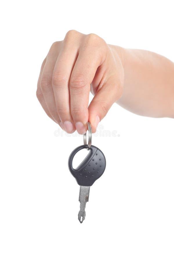 Рука женщины давая ключ автомобиля стоковая фотография rf