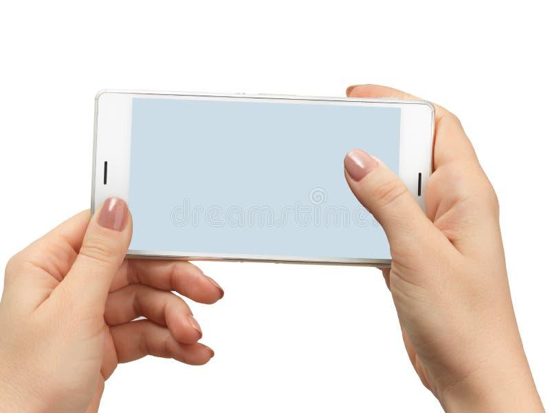 Рука женщины держа белый smartphone стоковая фотография rf