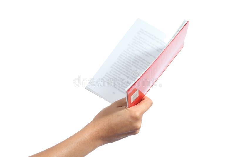 Рука женщины держа раскрытую книгу стоковое изображение