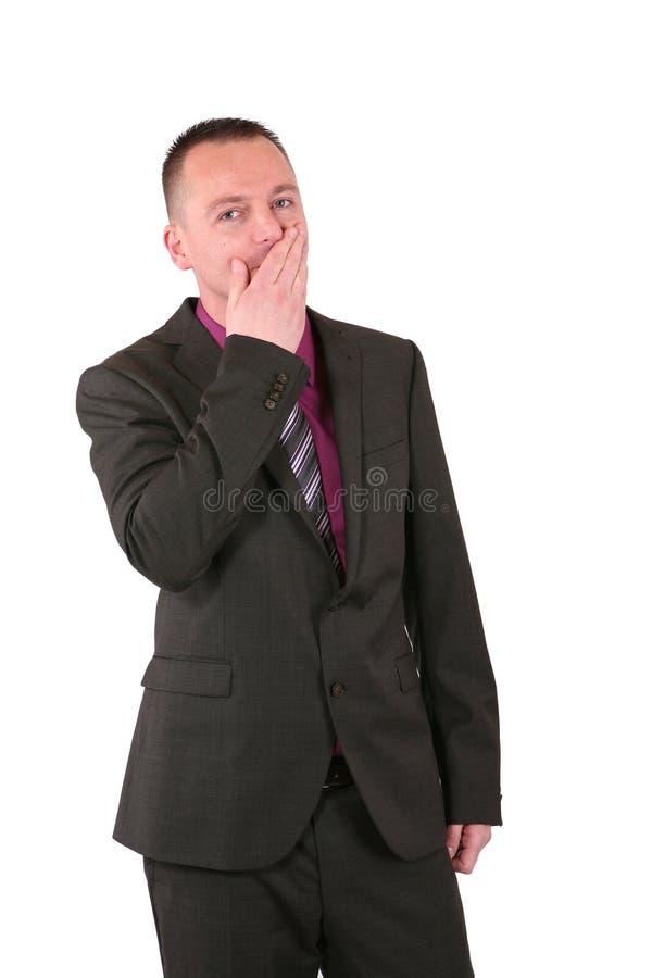 рука заволакивания бизнесмена его детеныши рта стоковая фотография