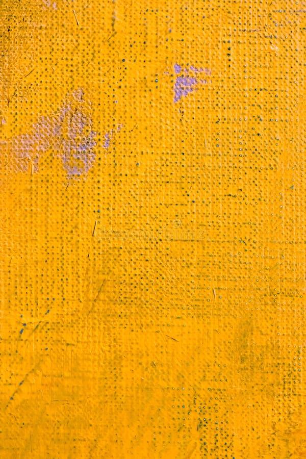 Рука искусства покрасила холст с акриловой яркой оранжевой краской стоковое фото rf