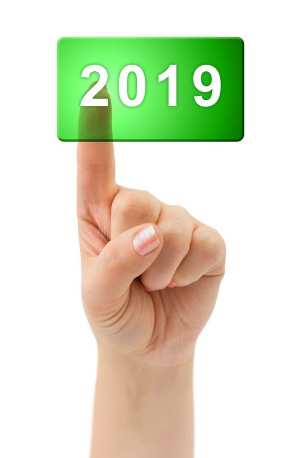 Рука и кнопка 2019 стоковое фото