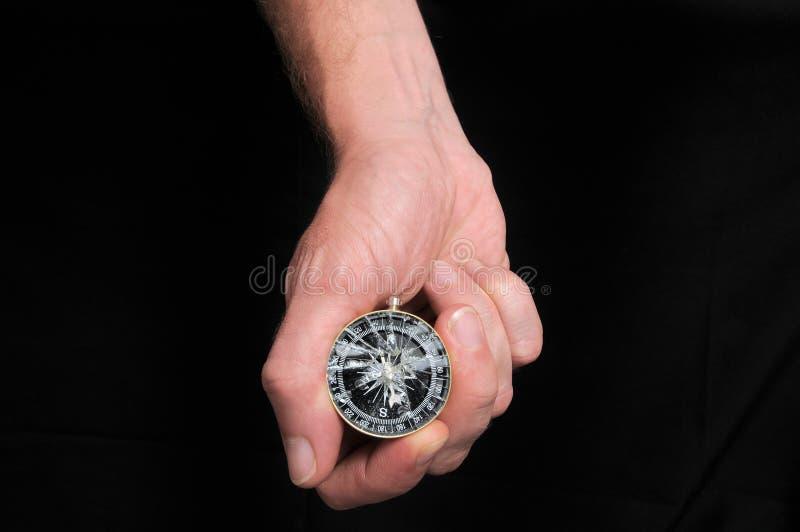 Рука и сломленный компас стоковое фото rf